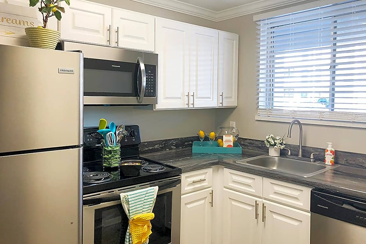 Newly renovated kitchens with white cabinetry, and stainless steel appliances are available.