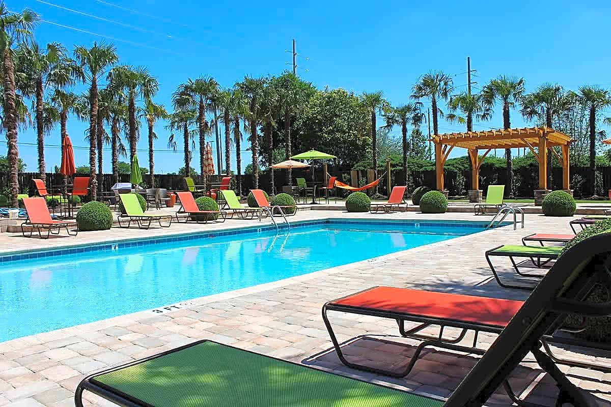 Resort-style pool with sundeck, cabanas and relaxing hammocks.
