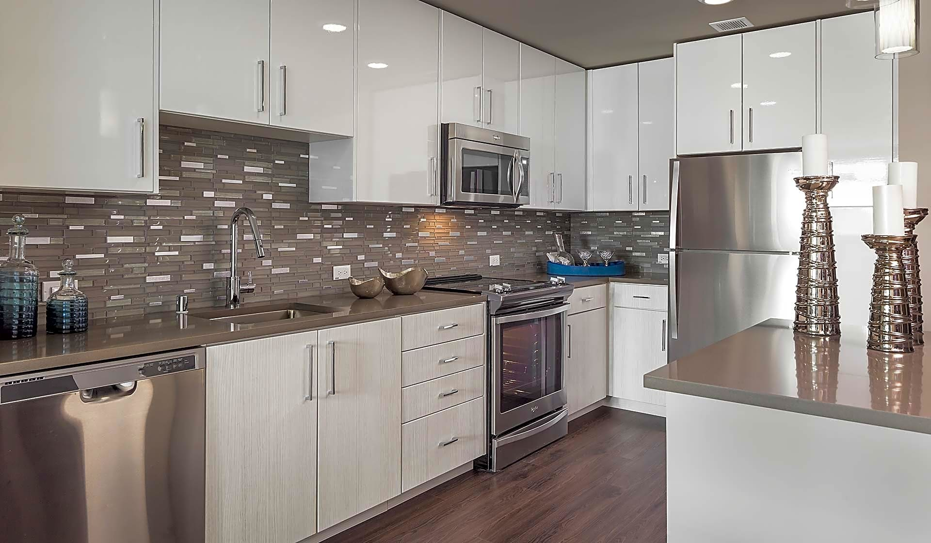 Modern kitchen featuring quartz countertops and stainless steel appliances