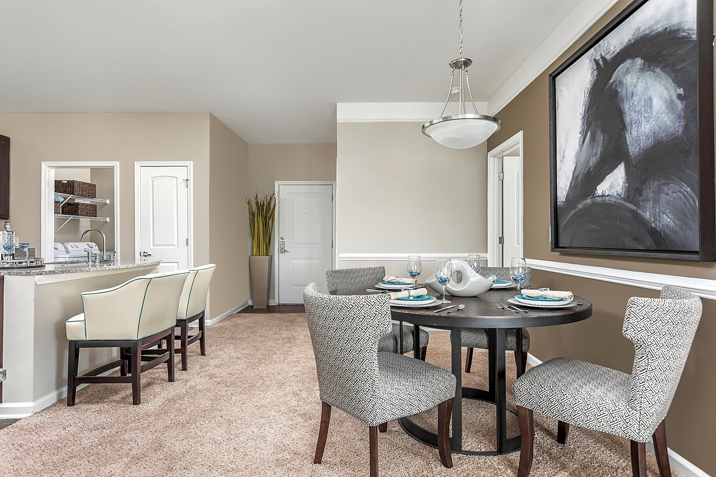 Open Living Room and Breakfast Bar - Aston Apartments