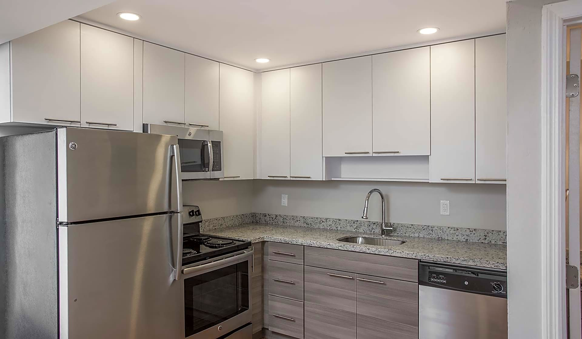 Modern kitchen features stainless steel appliances, granite countertops and designer cabinets