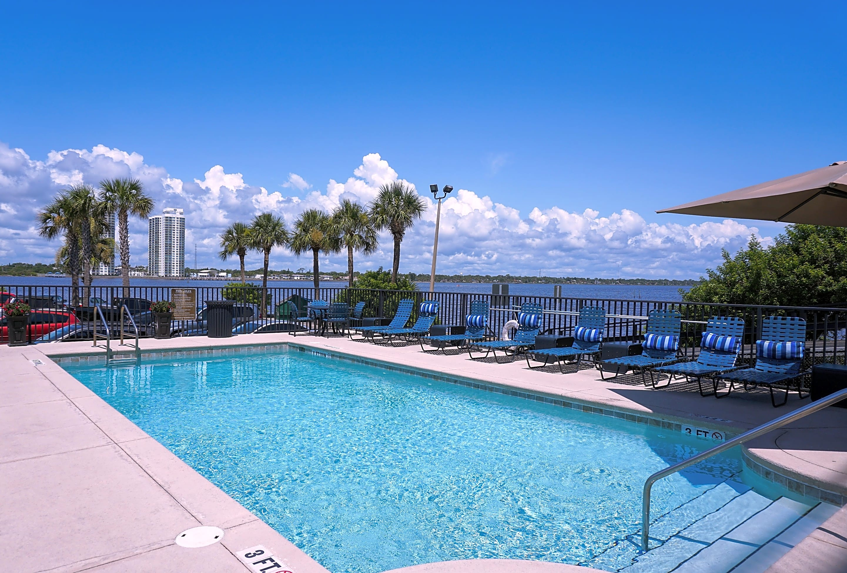 Swimming Pool with Sundeck Seating Overlooking the Intracoastal Waterway
