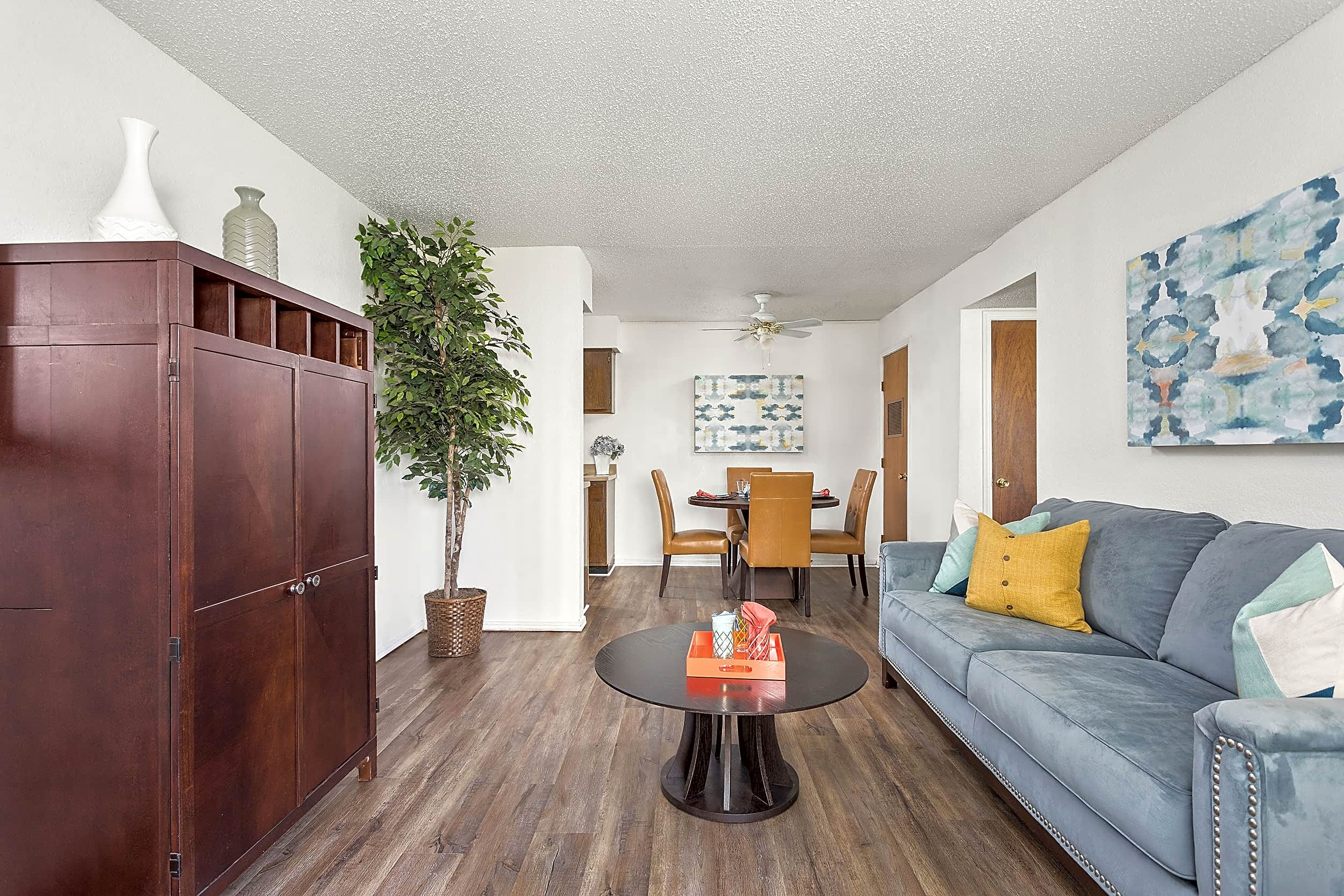 Long View of Living Room with Hardwood Floors - Raindance Apartments