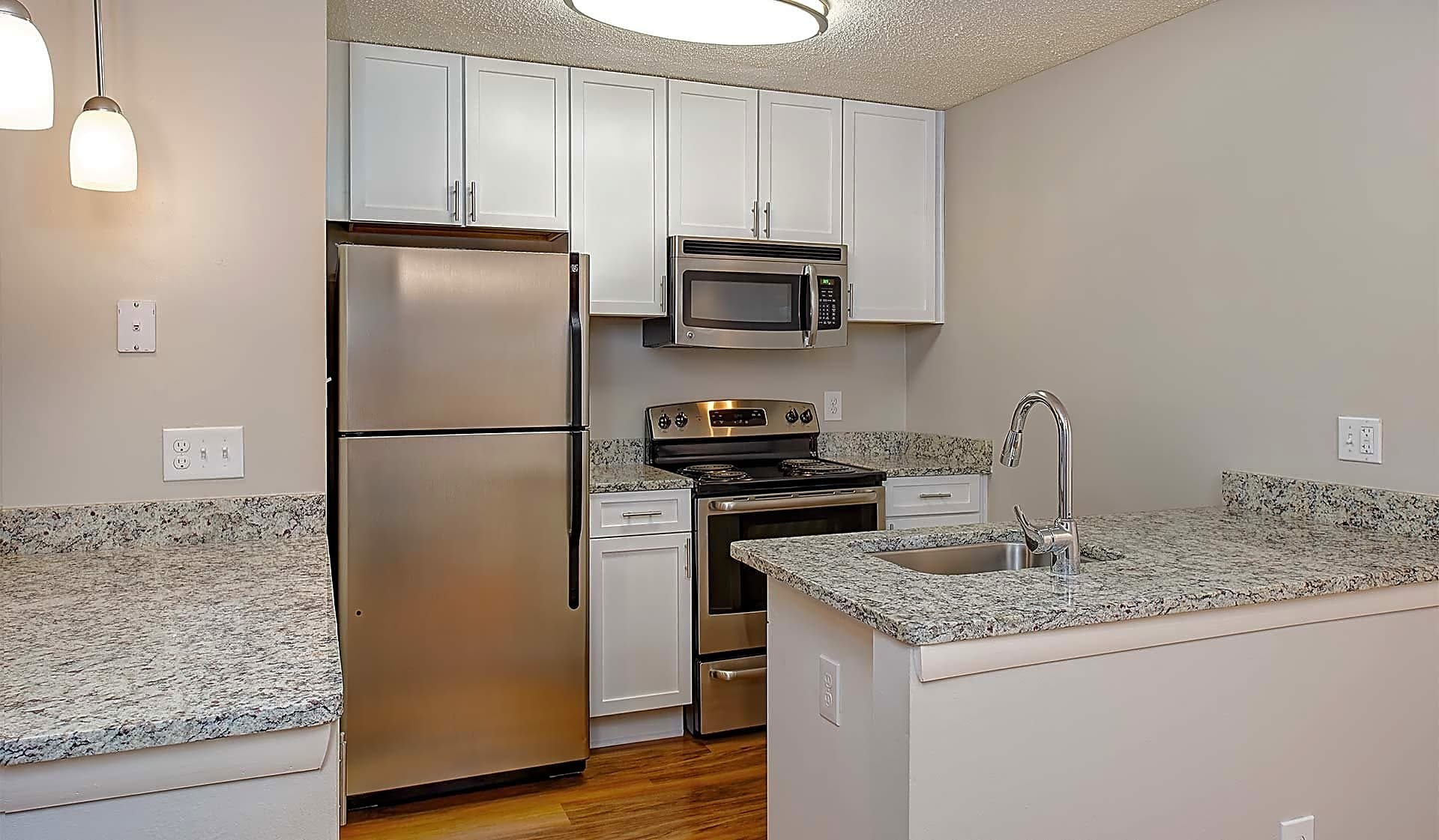 The Windsor and Cambridge kitchens feature a breakfast bar