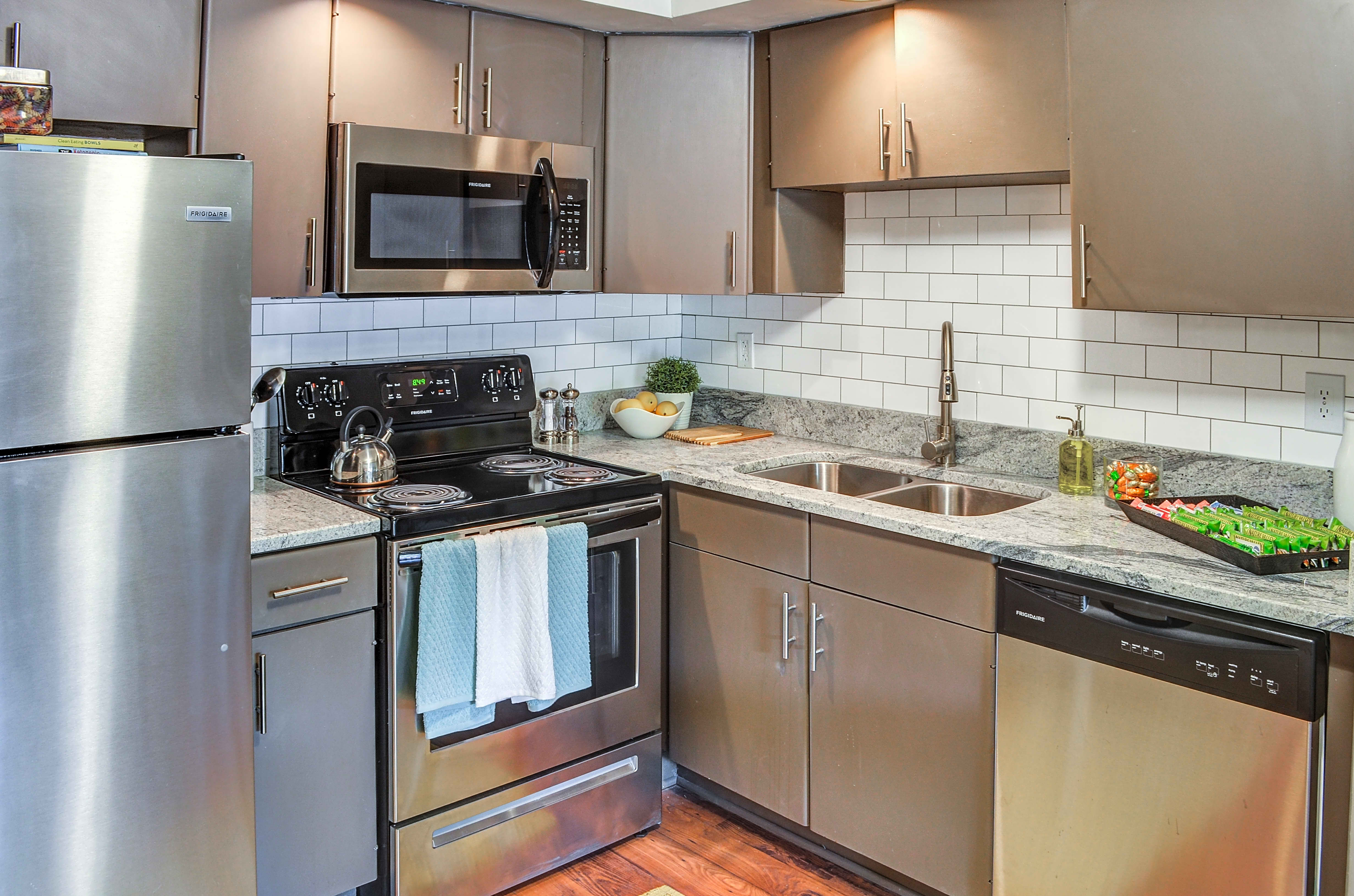 Can you please remove the dish towels from the stove since they are crooked? Thanks!