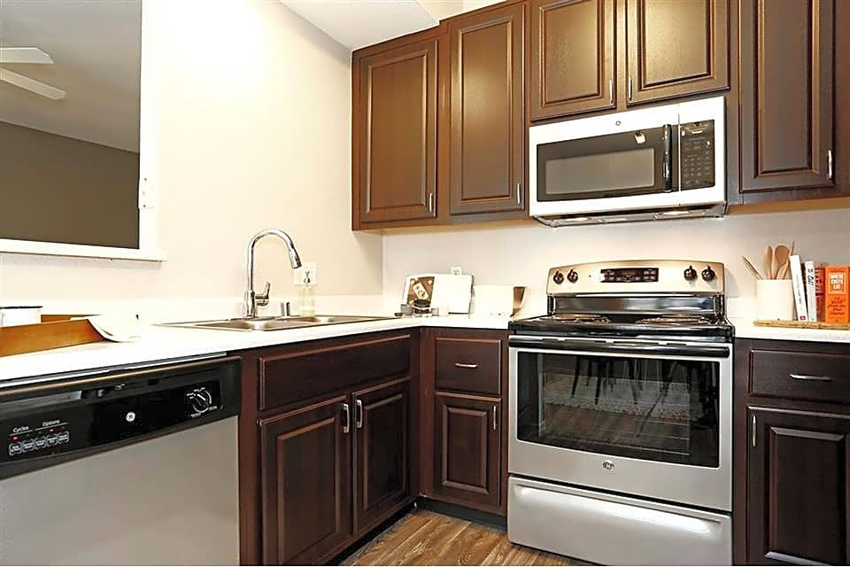 Newly renovated kitchens feature rich chocolate cabinetry and stainless steel appliances