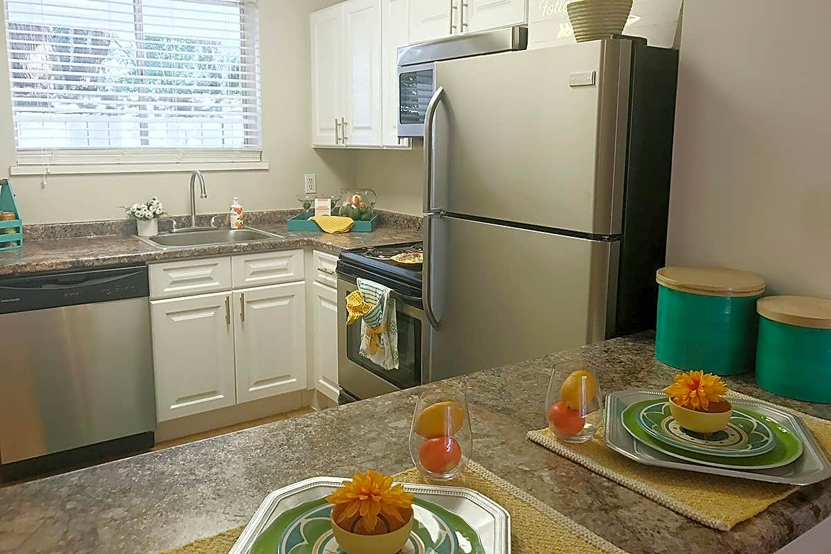 Updated kitchens complete with breakfast bars, pantry closet, and stainless steel appliances.