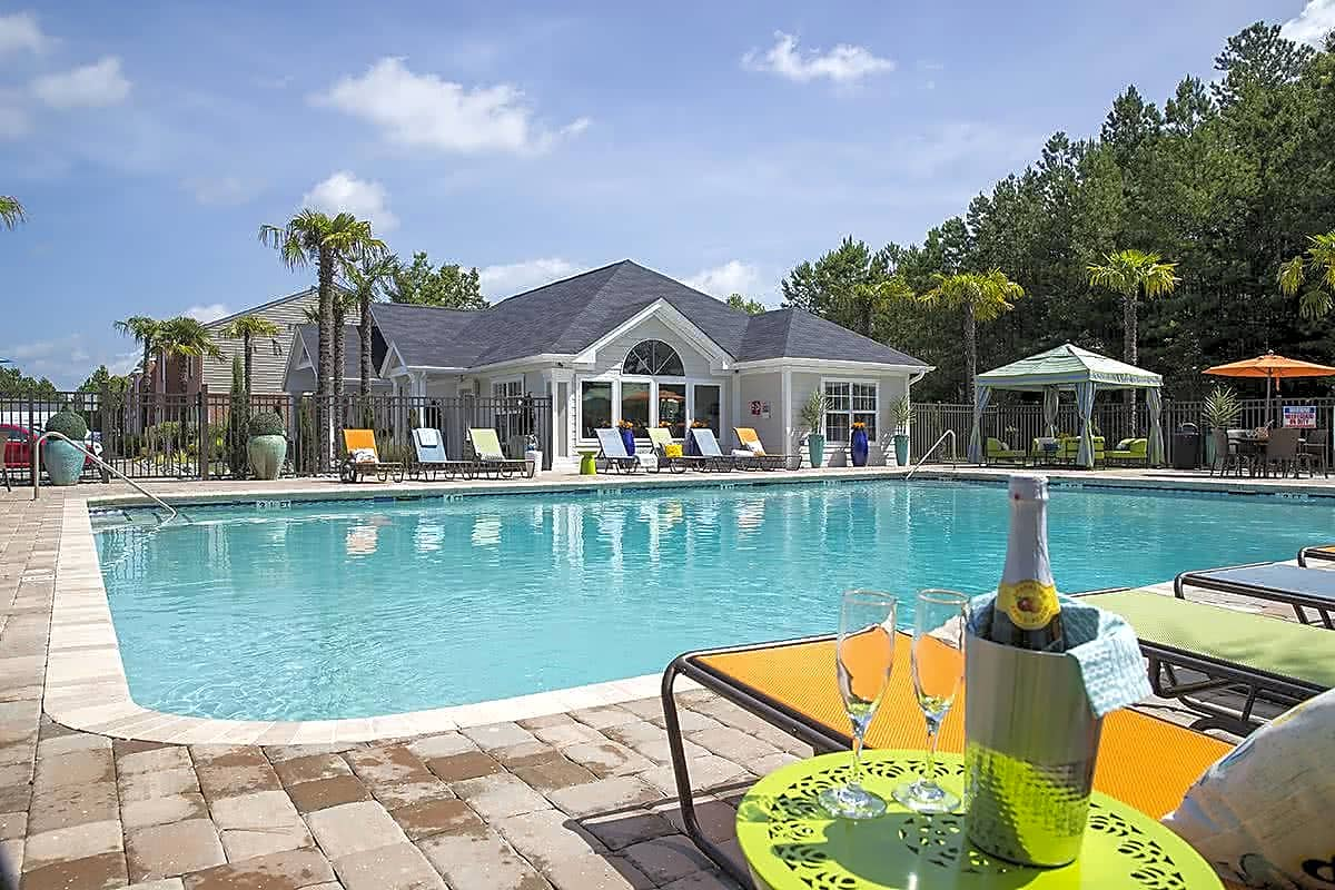 Resort-style pool featuring chase lounges and seating areas.