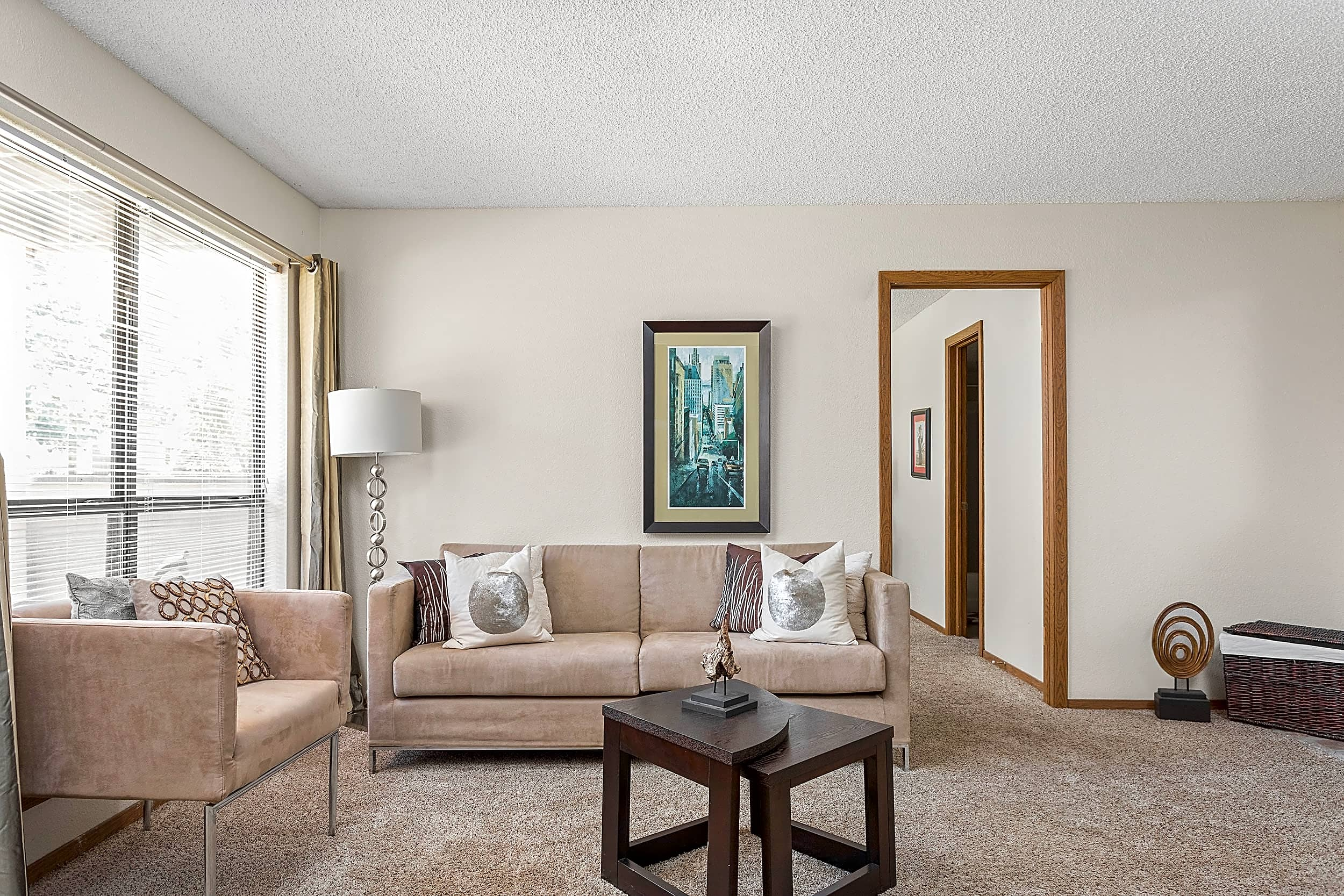 Spacious Living Room with Large Windows - Heritage Park Apartments