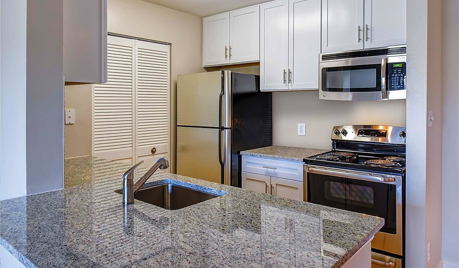 GE Clean Steel appliances and granite countertops in the Cedarcrest Premier