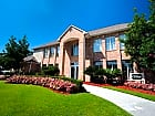 Oakbrook Village & Suites - Baton Rouge