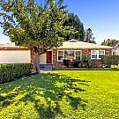 Beautiful shade trees frame this lovely home front - Riverside, CA 92504
