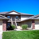 Lower unit apartment with single car garage - Raymore, MO 64083