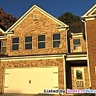 Lovely brick townhome with a spacious open... - Lawrenceville, GA 30046