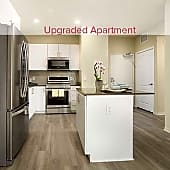 Upgraded Apartment Kitchen with Quartz Countertops, Stainless Steel Appliances and Hard Surface Vinyl Plank Flooring (in select apartments)