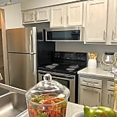 Completely renovated kitchen includes stainless appliance package, brushed nickel finishes and new cabinets.