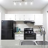 Crisp white cabinets and granite inspired counters in our newly renovated kitchens give them a modern feel