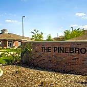 Pinebrook apartment community sign