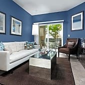 Living room with carpet (in select homes)