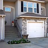 Front of townhouse with one car garage