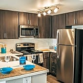 Newly renovated kitchen with espresso cabinets and tile backsplash