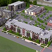 Aerial view of The Hamlet at Saratoga Springs featuring apartment buildings, The Fresh Market, and other retail