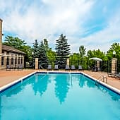 Scenic Swimming Pool with Foliage and Sundeck - Reserve at Eagle Ridge