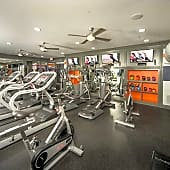 Extensive fitness center with cardio equipment and weights