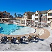 Zero Entry Outdoor Pool with Suntanning Decks, Fireplace, and Grills