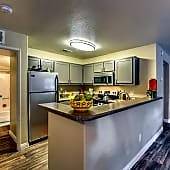 Large wrap around kitchen with breakfast bar.