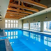 Indoor swimming pool with underwater speakers