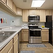 Kitchens with Hard Surface Plank Flooring and Stainless Steel Appliances (in select homes)