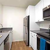 Renovated Kitchen with Quartz Countertops, New Cabinetry, Hard Surface Flooring and Stainless Steel Appliances