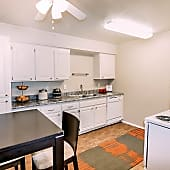 Light wood-look flooring throughout kitchen and living space