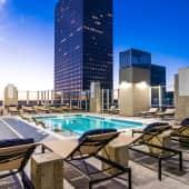 Rooftop, resort-style pool with sun shelf