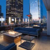 Rooftop social deck with lounge seating, flat-screen TVs and a gas fireplace