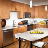 Island Kitchen with Quartz Countertops and Stainless Steel Appliances