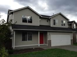 This 4 bed and 2.5 bath home has 2,072 square feet - Puyallup