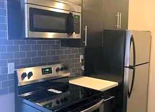 Remodeled kitchen with designer tile & cabinets and stainless steel appliances