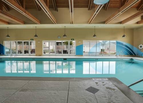 Indoor swimming pool with underwater speakers