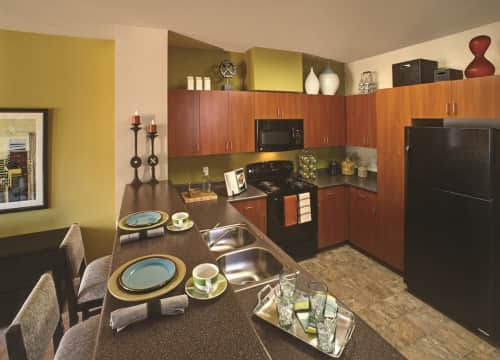 Kitchens Featuring Sleek Black GE Appliances And Granite Inspired Counter  Tops