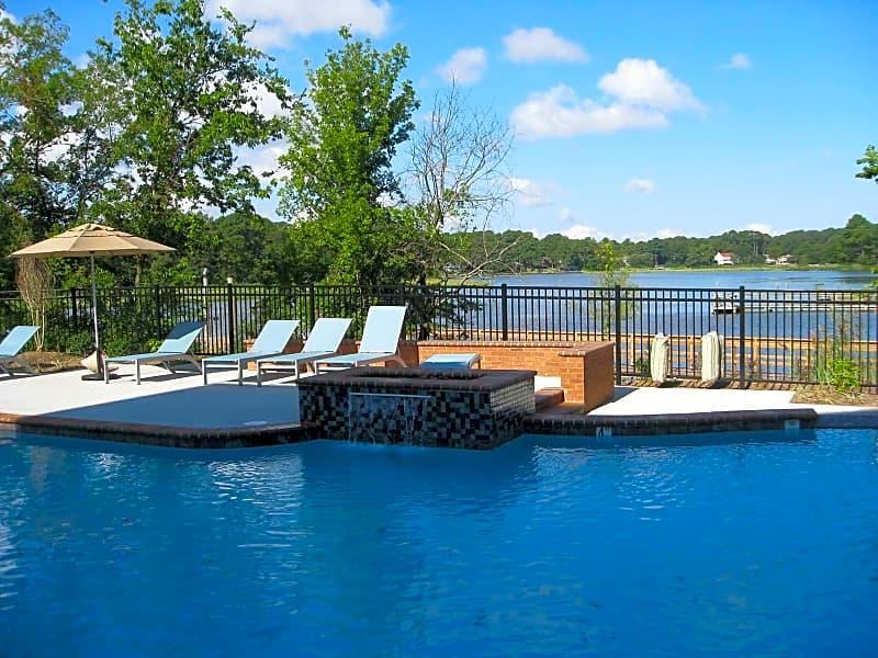 Resort style pool with water views