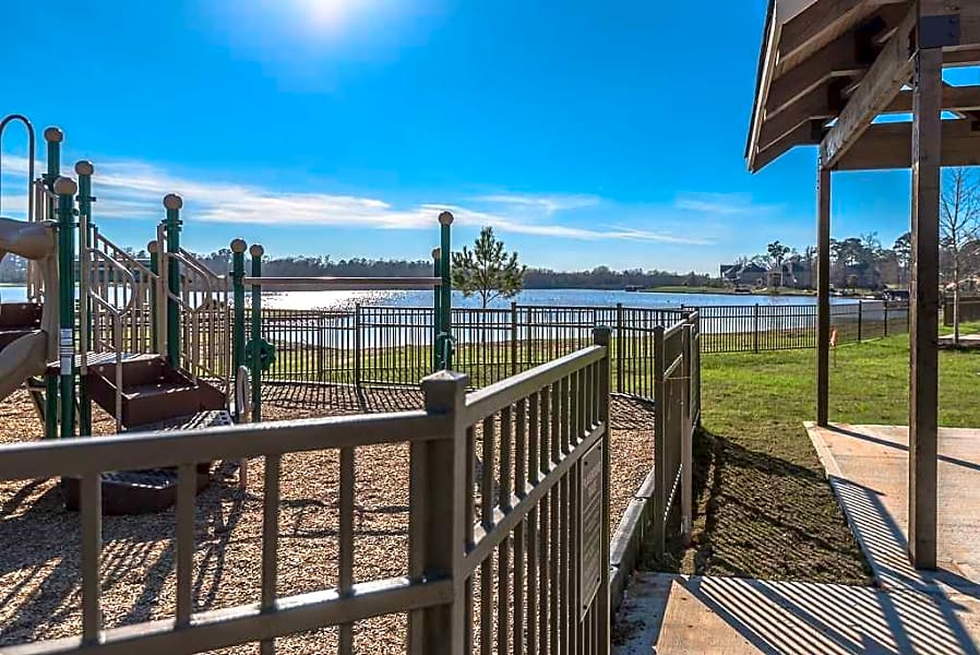 Playground with view of Lake Conroe