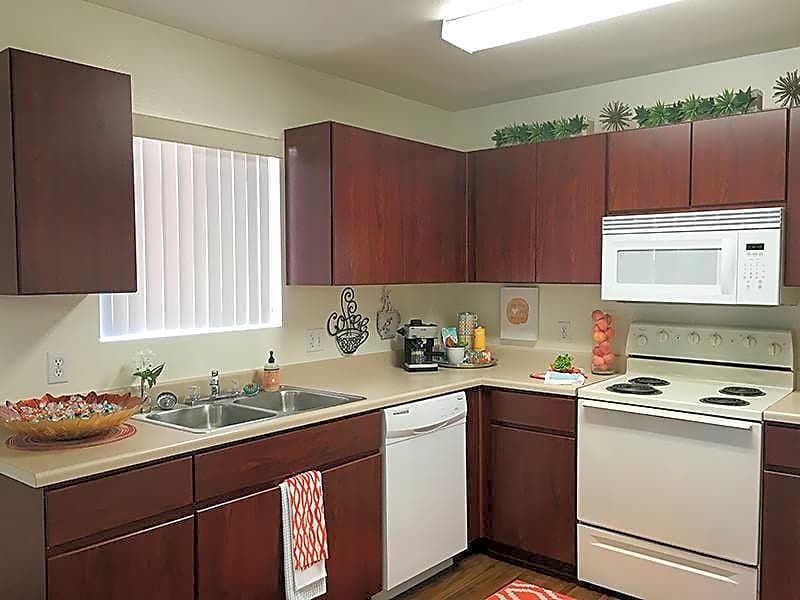 Spacious, open kitchens with ample cabinet space.