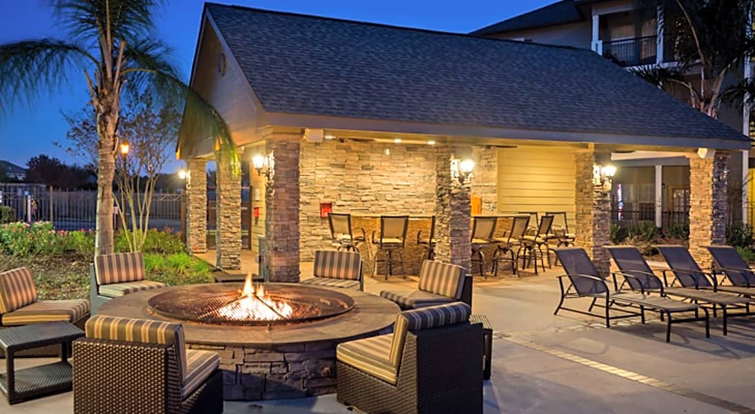 Firepit and Outdoor Seating at The Enclave at Woodbridge Apartments in Sugar Land, TX