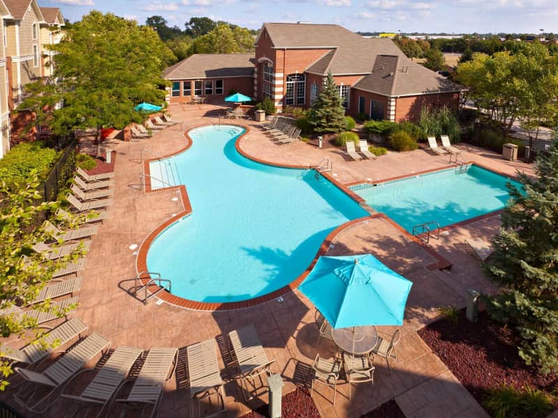 Resort-style pool with patio enclave, volleyball and sundeck