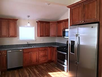 Brand new stainless steel appliances, cabinets and gleaming floors.jpg