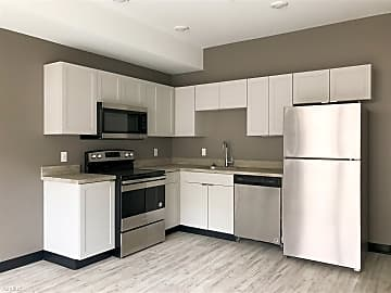 Spacious Kitchen Complete With Stainless Steel Appliances