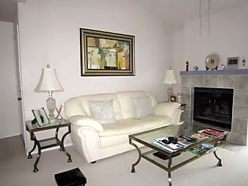 living room with marble fireplace