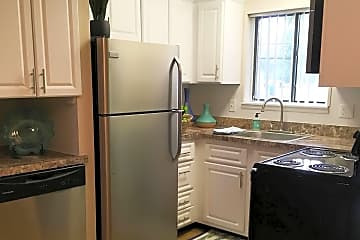 Newly updated kitchens featuring a built-in pantry are and a dishwasher.